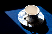 A Chinese tea cup silouetted in the morning light